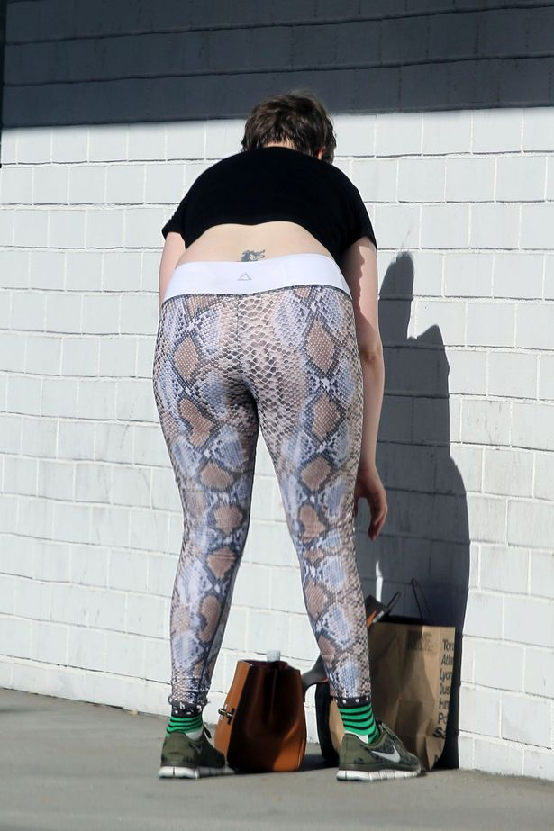 Lena-Dunham-spotted-leaving-the-gym-in-snake-print-leggings-in-LA